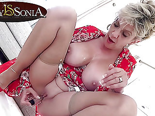 mature blonde Lady Sonia gets off with her new vibrator